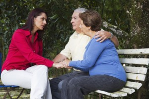 Hispanic woman giving senior Hispanic couple bad news